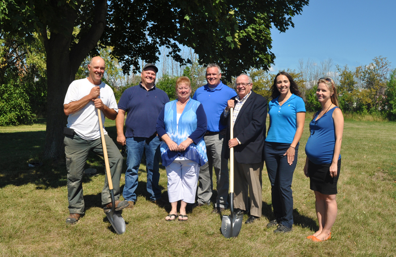 Mike Audit, Mike Graybeil, Councillor Angie Desmarais, Scott Luey, Mayor John Maloney, Amanda Upper and Sarah Lacharity pose for a picture at the site of the new community garden at Lockview Park in Port Colborne Ontario.