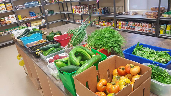 The Lockview Park Community Garden brought in a bounty of 853 kilograms of fresh, healthy produce to the Port Cares Food Bank. The picture shows fresh produce sitting across a table in the Port Cares pantry.