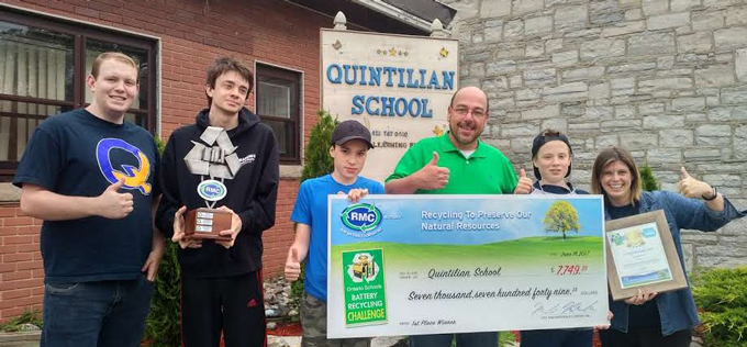 Ben Kersley of Raw Materials Company awards Quintilian Private School of Kingston with a 1st place trophy and cheque for winning the Ontario Schools Battery Recycling Challenge