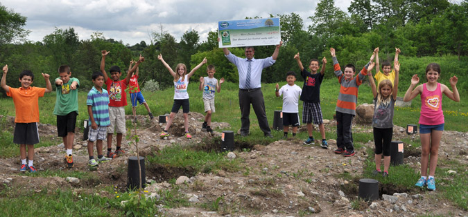 Rhema Christian School Students pose for a picture on the site where their eco classroom will be built using money received from winning the Ontario Schools Battery Recycling Challenge
