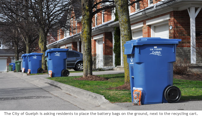 The City of Guelph asks residents to place the battery recycling bag on the ground next to the blue recycling cart on recycling day.