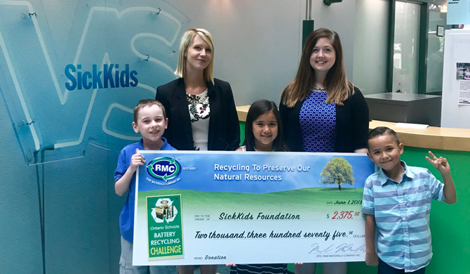 Student representatives from the Ontario Schools Battery Recycling Challenge make a donation to the SickKids Foundation on behalf of all OSBRC students!